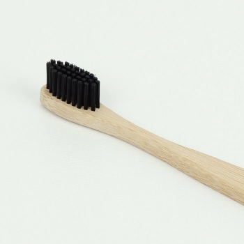 bamboo-carbon-toothbrush-with-charcoal-bristles (3).jpg